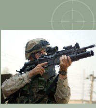 Army Soldier fielding M4 with M203 attachment.