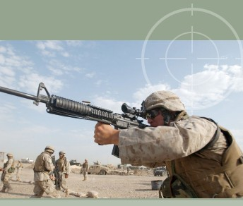 United States Marine firing an M16A4 with ACOG attachment. M16A4 with ACOG attachment will fit in a Combat Weapons Rack without removing the scope on the M16.