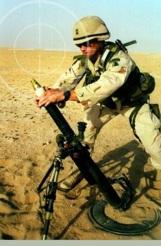 United States Army Soldier firing M224 60mm lightweight mortars during training excercises for Operation Iraqi Freedom. M-224 60mm lightweight mortars can be stored in Combat Weapons Storage Racks.