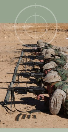 United States Marines firing M249 SAW during training excercises for Operation Iraqi Freedom. M-249 SAWs can be stored in Combat Weapons Racks with the bi-pod attached to the weapon.