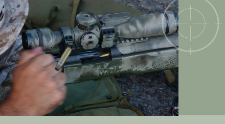 United States Marine firing M40A3 sniper rifle during training excercises for Operation Iraqi Freedom. M-40 sniper rifles can be stored in Combat Weapons Storage Racks with the bi-pod attached to the weapon.