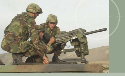 United States Army Soldiers firing a crew-served Mark 19 (MK-19) machine gun during training excercises for Operation Iraqi Freedom. MK19s can be stored in Combat Weapons Storage Racks.